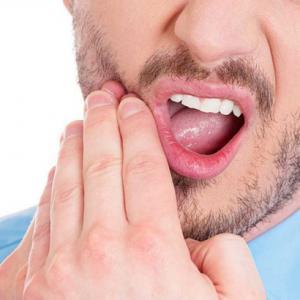 dente obturado inflamado